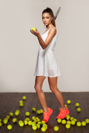 beautiful sporty sexy woman, tennis player with racket ready to hit a tennis ball Archivio Fotografico