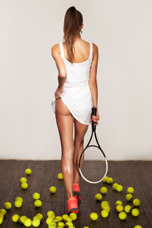 skimpy: beautiful fitness sexy woman, tennis player with racket Stock Photo