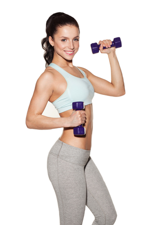 sporty woman do her workout with dumbbells, isolated on white background Archivio Fotografico
