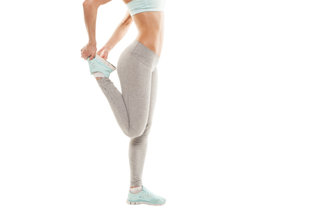 Fitness woman is stretching before jogging. Fitness and lifestyle concept. Gym workout