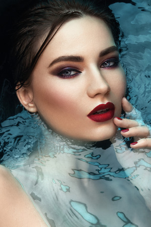 beauty portrait in water, fashion vogue style shoot, close up makeup