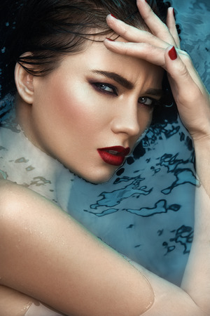 fashion style: beauty portrait in water, fashion vogue style shoot, close up makeup