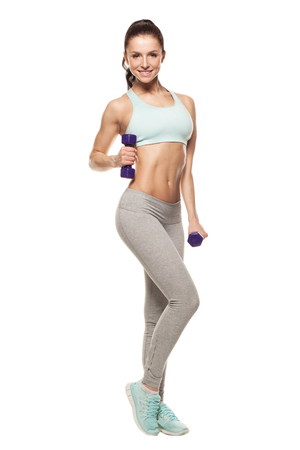 sporty woman do her workout with dumbbells, isolated on white background Foto de archivo