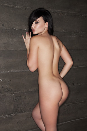 beautiful naked woman: naked beautiful woman near the wall, beautiful brunette, fashion nude photoshoot