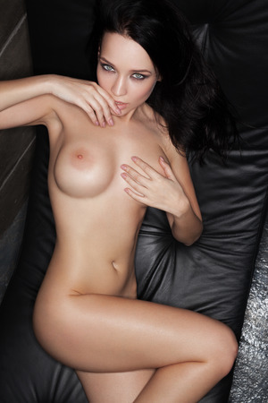 topless brunette: naked beautiful woman on the chair, beautiful brunette, fashion nude photoshoot