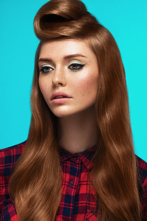 red-haired girl, freckled face, trendy makeup and hairstyle, curly woman Archivio Fotografico