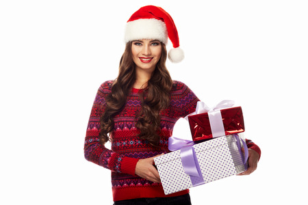 Portrait of a beautiful woman wearing a santa hat smiling, warm sweater, isolated on white background, new year Stock fotó