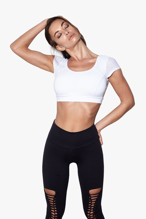 attractive fitness woman, sexy trained female body, lifestyle portrait, caucasian model,  does the exercises