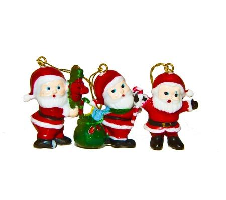 three santas stock photo isolated on white backround