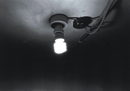 Black and white lightbulb with visible wires.