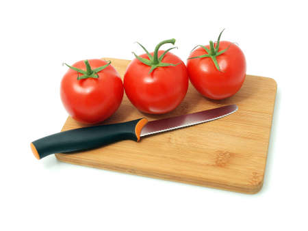 Red tomatoes on the white background