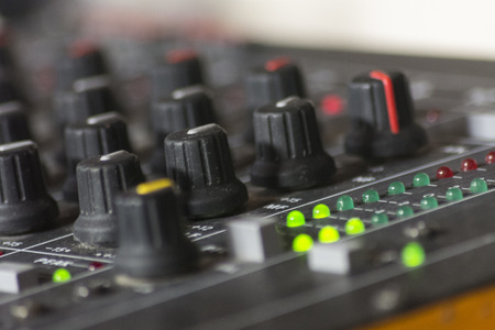 control panel lights: Potentiometers trimmers and VU meter peak volume lights in a mixer table, production studio, concert or deejay booth.