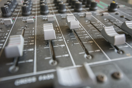 trimmers: Faders and potentiometers trimmers in a mixer table, production studio, concert or deejay booth.