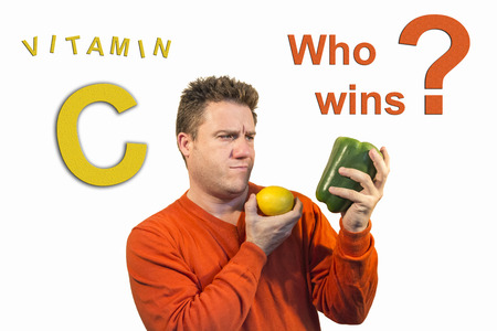 specifically: Doubting guy holding fruits and vegetables, specifically a pepper and lemon