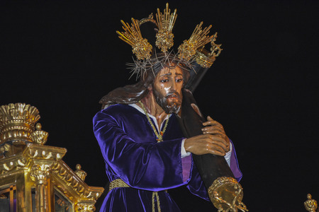 Holy week procession in Spain, Andalusia. Nazarene Jesus, Our Lady of Sorrows.