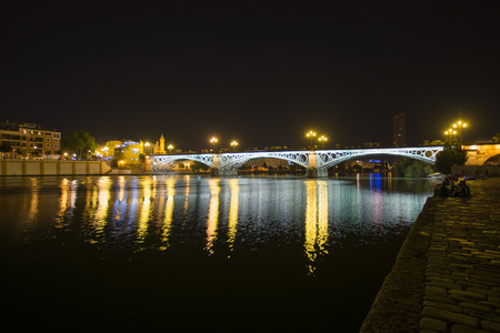 isabel: Night view of the Triana Bridge in Seville, Spain. Also called Isabel II bridge.