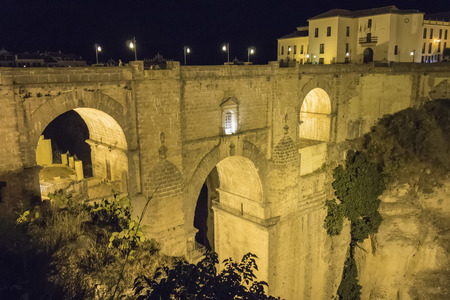 ronda: View of Ronda old stone bridge at night, Malaga, Spain Stock Photo