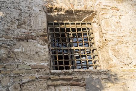window bars: Window bars in facade of old house