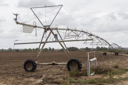 pivot: Irrigation pivot system watering Stock Photo