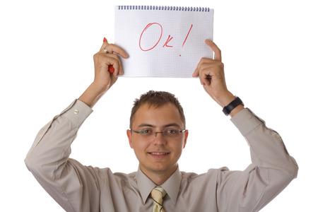 businessman with notebook write Ok isolated on white background photo