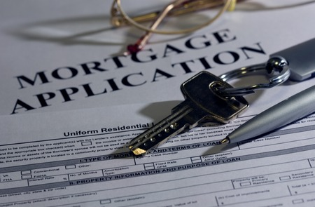 Mortgage loan application form and key Stock Photo - 1366194
