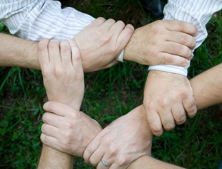 unbreakable: ring of hands teamwork Stock Photo