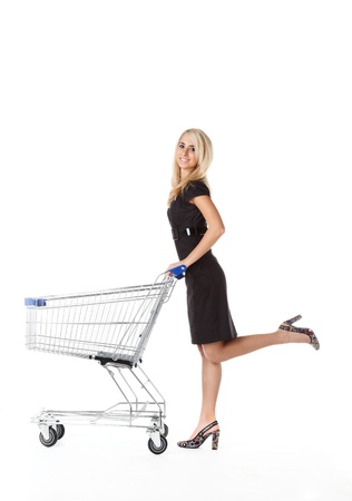 full shopping cart: beautiful woman  with  cart
