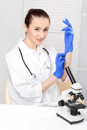 Medical - Female Nurse Looking In Microscope photo
