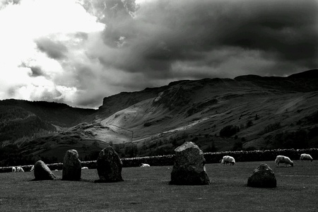 dark: Black and white landscape with dark clouds, animals and ancient pagan stone circle