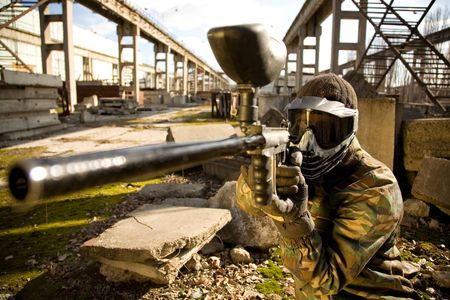 paintball: Paintball player with gun  Stock Photo