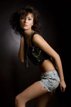 Sensual girl in mini skirt isolated in studio Stock Photo - 3019866