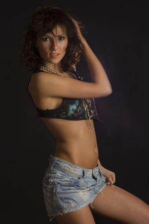 Smiling girl in mini skirt isolated in studio Stock Photo - 3085769