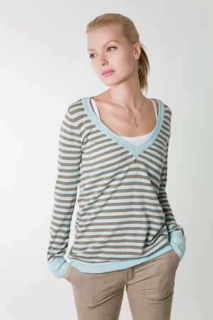 stripped:  young girl in stripped sweater on white background
