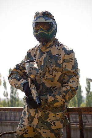 thrilling: Paintball player in camouflage uniform