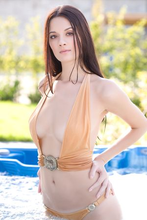 Beautiful young girl in glamour swimming pool Stock Photo - 3670714