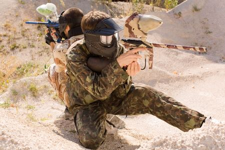Paintball player hunting outdoors Stock Photo