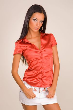 Sensual girl in red blouse, studio isolated
