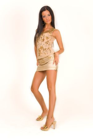 Attractive girl in miniskirt, studio isolated Stock Photo