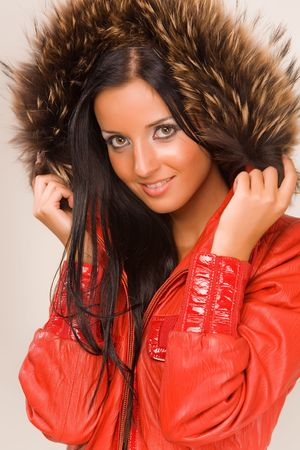 Pretty smiling girl in red jacket  Stock Photo - 3705990