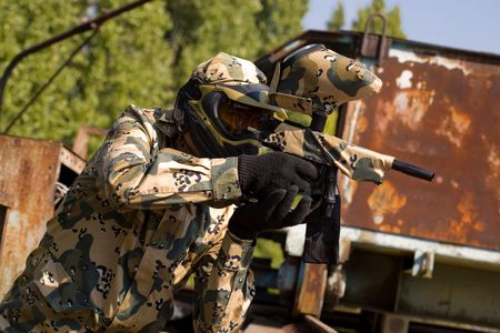 3742665: Paintball player outdoors  Stock Photo