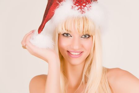 Smiling mrs. Santa in red hat Stock Photo - 3775309