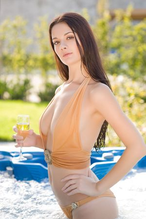Young girl with champagne glass in Jacuzzi  photo