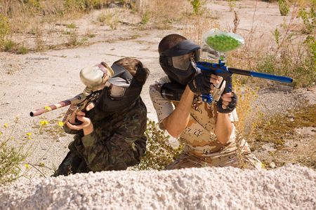 thrilling: Two paintball players hunting outdoors over nature background  Stock Photo