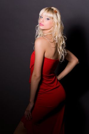 Attractive girl in red dress, isolated on black background Stock Photo