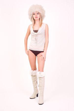 Young girl in furry hat, studio shot Stock Photo - 3883845