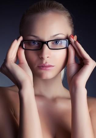Portrait of a beautiful girl in stylish glasses, studio shot