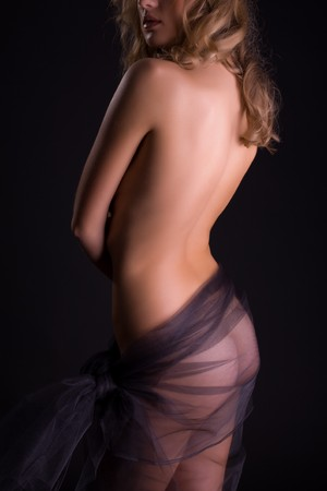 Sensual girl in transparent skirt, studio shot