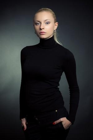 Beautiful blond girl, studio shot  Stock Photo