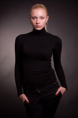 Beautiful blond girl in black sweater, studio shot  Stock Photo - 4361551