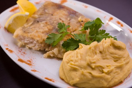 Fried fish and hummus, selective focus  photo